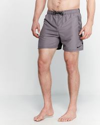 60326907bd Nike Solid Vital Swim Trunks in Black for Men - Lyst