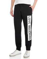 Love Moschino - Vertical Logo Joggers - Lyst