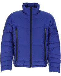 Prada Triangle Logo Puffer Jacket - Blue