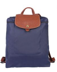 70be2898d3ef Hot Longchamp - Le Pliage Folding Backpack - Lyst