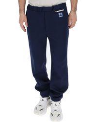 Prada Logo Patch Jogger Trousers - Blue