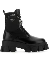 Prada Strapped Pouch Boots - Black