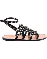 b90c66a45ca Lyst - Valentino Rockstud Ankle-Strap Flat Sandal in White