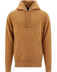 Balmain Logo Embossed Hoodie - Brown