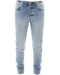 Amiri Slit Knee Skinny Jeans - Blue