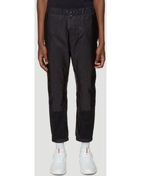 Prada Logo Patch Paneled Sweatpants - Black
