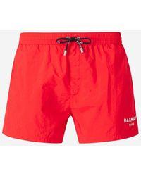 Balmain Metallic Logo Print Swim Shorts - Red