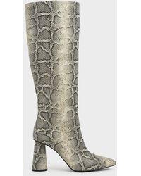 Charles & Keith Snake Print Knee High Heeled Boots - Gray