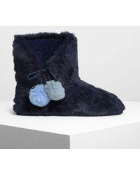Charles & Keith Furry Pom Pom Boots - Blue
