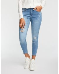 Charlotte Russe - Mid Rise Push Up Skinny Jeans - Lyst