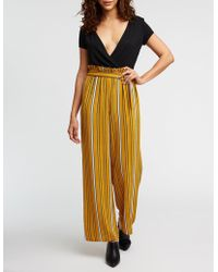 68841ba358f Lyst - Charlotte Russe Paperbag Striped Jumpsuit - Save ...