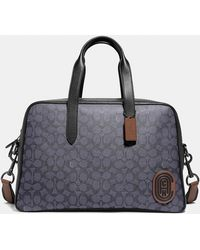 COACH Metropolitan Soft Carryall In Signature Canvas With Patch - Black