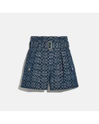 COACH : Short exclusif avec ceinture - Bleu