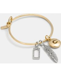 COACH - Pave Feather Hoop Bangle Charm Set - Lyst