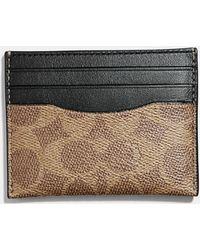 c431b91a377d Lyst - COACH Bleecker Double Billfold Wallet In Signature Coated ...