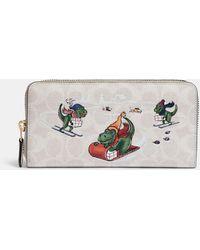 COACH Accordion Zip Wallet In Signature Canvas With Rexy - Multicolor
