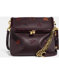 COACH - Rider Bag 24 With Star Applique And Snakeskin Detail - Lyst