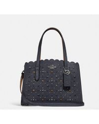 COACH - Charlie Carryall 28 With Prairie Rivets - Lyst