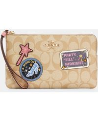 COACH Disney X Large Corner Zip Wristlet In Signature Canvas With Patches - Multicolor