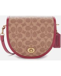 COACH - Runway Coach Originals Coated Canvas Signature Turnlock Saddle Cross Body Bag - Lyst