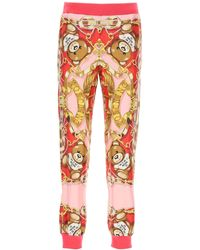 Moschino Silk jogger Pants With Foulard Print - Orange