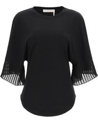 See By Chloé - TOP CON MANICHE PLISSETTATE - Lyst