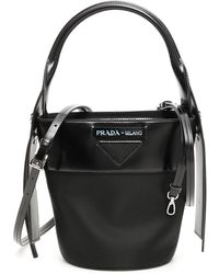 cbafa2c29856 Prada Stud-embellished Nylon Cross-body Bag in Black - Lyst