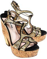 Miu Miu Gold Glitter Strappy Cork Platform Heels - Metallic