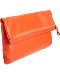 Barneys New York Foldable Zip Clutch red - Lyst