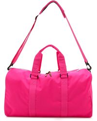 Herschel Supply Co. Ravine Duffel Bag Neon Pink - Lyst
