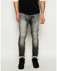 Wrangler Jeans Bryson Skinny Fit Grey Roads Stretch Mid Wash