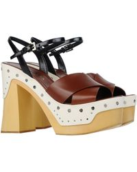 Prada Sandals brown - Lyst