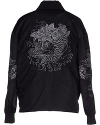Moncler Down Jacket black - Lyst