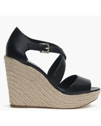 4aae06d0780b Michael Kors - Abbott Black Leather Wedge Sandals - Lyst