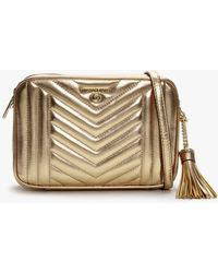 Michael Kors Jet Set Pale Gold Leather Tassel Charm Camera Bag - Metallic