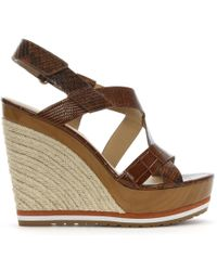 5bb1d3be1610 Michael Kors - Mackay Luggage Leather Embossed Wedge Sandals - Lyst