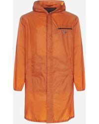 Prada Logo-plaque Nylon Piuma Hooded Raincoat - Orange