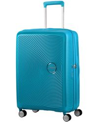 American Tourister - Curio 55cm Spinner - Lyst