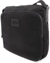 Lacoste Street Balance Black Strap Bag - Lyst