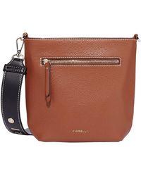 Fiorelli - Tan Zeplin Bucket Crossbody Bag - Lyst