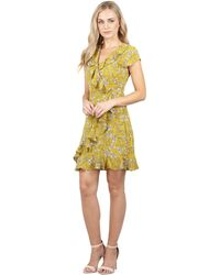 Izabel London - Mustard Floral Wrap Tea Dress - Lyst