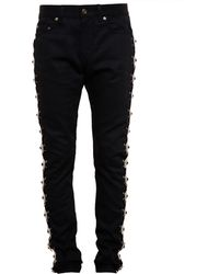 Saint Laurent Skinny Jeans With Concho Embellishment - Lyst