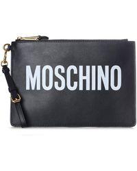 da4ec0c73d Moschino Leather Logo Wristlet Clutch in Black - Lyst