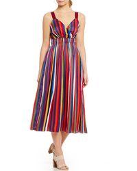 aed39966247 Lucy Paris - Aurora Rainbow Stripe Surplice V-neck Midi Dress - Lyst