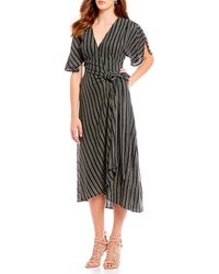 669cbd29a047 Eva Franco - Stripe Hi-low Wrap Style Midi Dress - Lyst