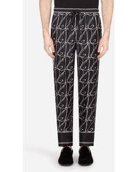 Dolce & Gabbana Silk Pajama Pants With All-Over Dg Print - Noir