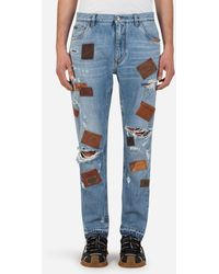 Dolce & Gabbana Loose Jeans With Rips And Multiple Patches - White