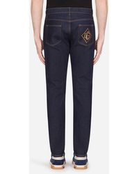 Dolce & Gabbana Slim-fit Stretch Jeans With Patch - Blue