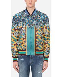 Dolce & Gabbana Feather-Print Nylon Jacket With Dg Logo - Blau