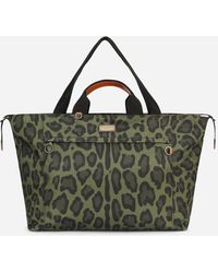 Dolce & Gabbana Nylon Travel Bag With Leopard Print Against A Green Background And Branded Plate